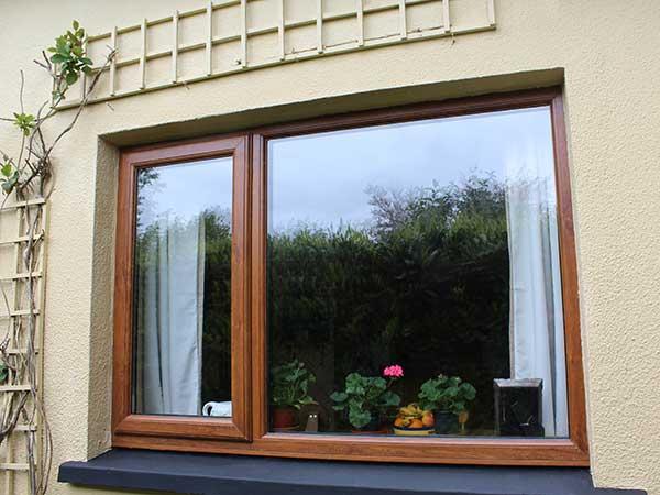 upvc window in golden oak