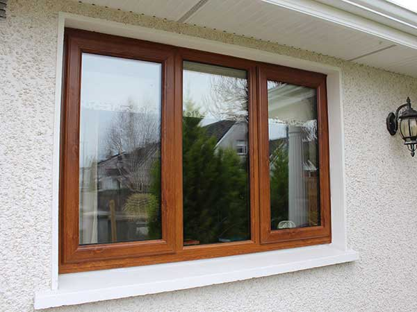 upvc window in golden oak